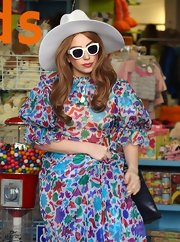 Lady Gaga went mod in a pair of white plastic shades.