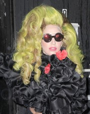 Lady Gaga topped off her theatrical look with a pair of round shades.