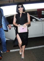 Lady Gaga turned heads at LAX with this two-tone leather purse, LBD, and evening pumps combo.