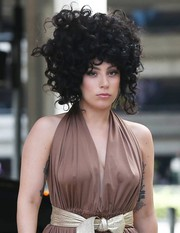 Lady Gaga rocked a curly black wig while catching a flight at LAX.