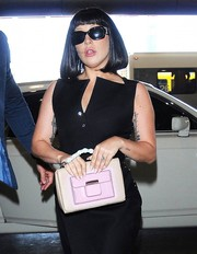Lady Gaga hid her eyes behind a pair of rectangular sunnies as she arrived at LAX.