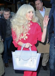 Lady Gaga headed out in New York City sporting a lilac Versace tote and red jumpsuit combo.