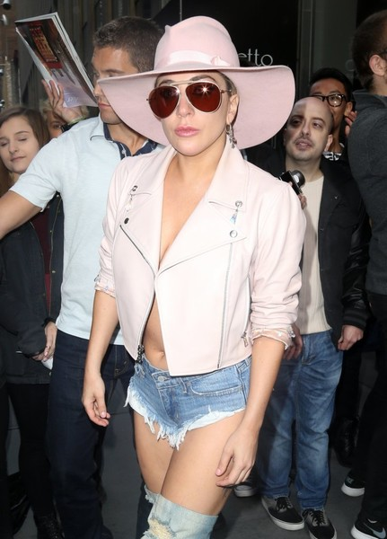 Lady Gaga stepped out of the Sirius Radio building rocking a pair of red aviators and a pink cowboy hat.