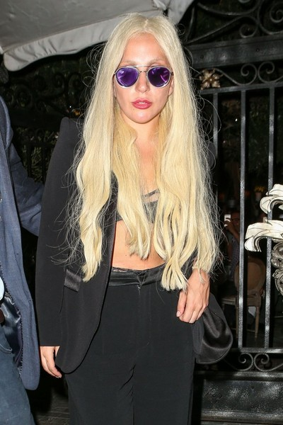 Lady Gaga looked hip in purple aviators while facing paparazzi flashbulbs in Beverly Hills.