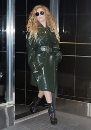 A deep forest green raincoat kept Lady Gaga's look classic and sleek.
