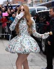 Lady Gaga teamed bow-adorned white gloves with a floral fit-and-flare dress for her appearance on 'David Letterman.'