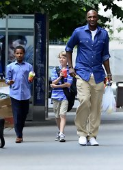 Lamar Odom went out for a stroll in New York wearing a cool ensemble consisting of a chambray button-down shirt and khakis.