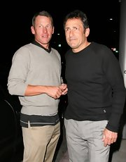 Lance Armstrong chose a casual look for dinner with this gray v-neck sweater.