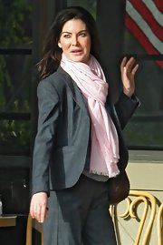 Lara Flynn Boyle livened up her subdued pantsuit with a voluminous pink scarf.