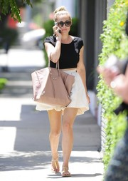 We wonder what Lauren Conrad is toting around in her chic leather handbag.