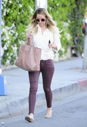 Lauren Conrad engaged in a little retail therapy wearing a pair of burgundy pants.