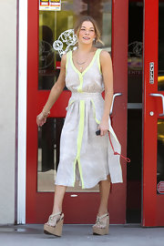 LeAnn Rimes attended a birthday party wearing a pair of very tall strappy wedge sandals.