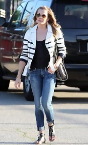 LeAnn Rimes chose a white leather jacket with horizontal black stripes to top off her casual look while at her stepson's baseball game.
