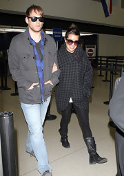 A smiley Lea Michele made her way through LAX in black leather mid-calf boots.