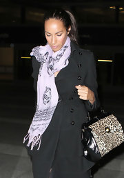 Leona Lewis looked ladylike carrying a leopard print tote. The bag added an exotic finish to her casual look.