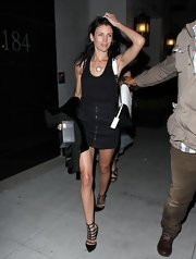 Liberty Ross showed off her toned figure with this black tank, which she paired with a sleek mini skirt.