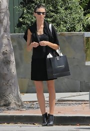 Liberty Ross kept her look black from head to toe when she wore this pleated mini skirt with a black tank, cardigan, and booties.