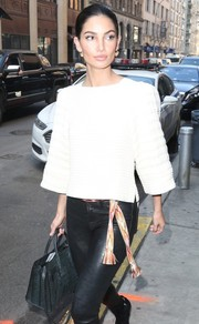 Lily Aldridge styled her leather pants with an embroidered canvas belt by Isabel Marant.