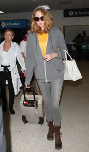 Lily Cole was dressed down in gray skinny jeans and a hoodie during a flight to LA.