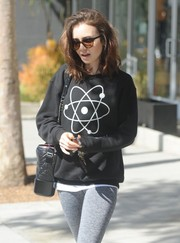 Lily Collins styled her sporty outfit with an elegant quilted shoulder bag for a day out in LA.