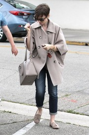 Lily Collins bundled up in a baggy beige pea coat for a day out in Beverly Hills.