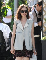 Lily Collins shaded her eyes with a pair of square sunglasses while strolling in Los Angeles.
