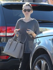 Lily Collins ran errands wearing a chic pair of tortoiseshell cateye sunnies by Elizabeth and James.