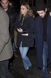 Lily-Rose Depp punched up her look with a pair of embellished ankle boots.