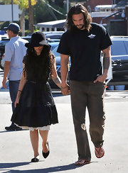 Lisa Bonet headed out for lunch wearing a casual black day dress over a lacy white lining.