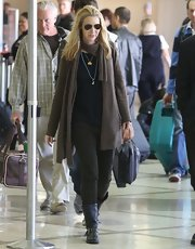Lisa Kudrow was spotted at LAX wearing a dark ensemble and aviators.