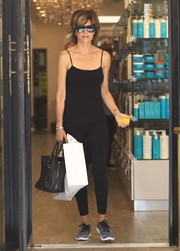 Lisa Rinna showed off her ageless figure in a fitted black cami while visiting a beauty salon.