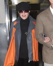 Liza Minelli was seen wearing a long strand necklace with gold cross pendant.