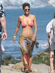 She is 45, ladies and gentlemen, 45! Check out that killer bikini-bod. Oh, and the super cute pink swimsuit.