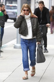 A pair of slide sandals completed Lori Loughlin's ensemble.