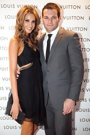 Laura Dundovic opted for a simple gray suede clutch to complete her ensemble at the Louis Vuitton store opening.