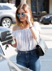 Lucy Hale flaunted a chic quilted leather bag by Chanel while visiting Starbucks.