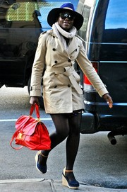 Lupita Nyong'o added a bright pop with her red leather tote.