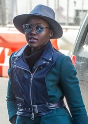 Lupita Nyong'o accessorized with cool mirrored shades by Dior for a visit to the Public Theater.
