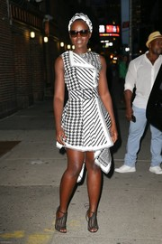 Lupita Nyong'o completed her outfit with a pair of black mesh peep-toe heels.