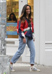 Malia Obama teamed her jacket with a pair of faded boyfriend jeans.