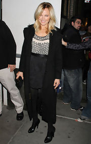 Malin Akerman complemented her monochromatic attire with black leather ankle boots.