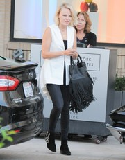 For her shoes, Malin Akerman chose a pair of multi-buckled suede ankle boots.