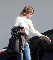 Mandy Moore accessorized with a stylish black leather tote while running errands in Beverly Hills.