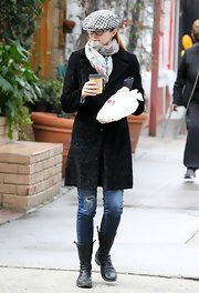 Marcia Cross bundled up in this black wool coat and funky newsboy cap.
