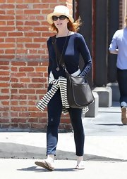 Marcia Cross was the model of classic preppiness when she wore this navy boatneck sweater and skinny jeans.s