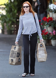 Marcia Cross brought a touch of nautical style into her casual wear with a striped cinch front hoodie.
