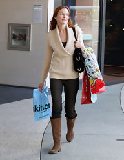 Marcia Cross hit the shops looking casual yet chic in brown suede knee high boots.