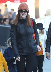 Marcia Cross kept cozy in a rust-colored knit beanie.