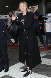 Margot Robbie landed at LAX carrying an edgy-chic studded leather bag by Burberry.
