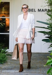 Maria Sharapova injected a flirty touch with a tiered pink mini skirt.
